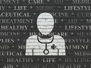Healthcare concept: Painted white Doctor icon on Black Brick wall background with  Tag Cloud
