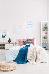 Pouf in cozy bedroom interior