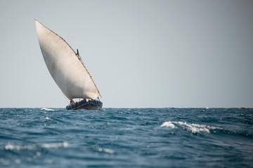 Traditional Dhow boat sailing near Zanzibar island, Tanzania