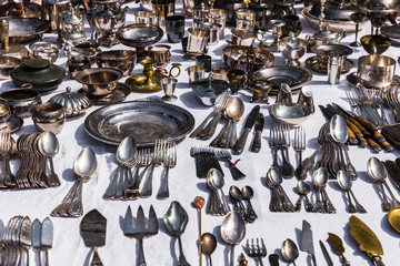 Vintage silver cutlery and tableware at a garage sale at the flea market in Paris. France