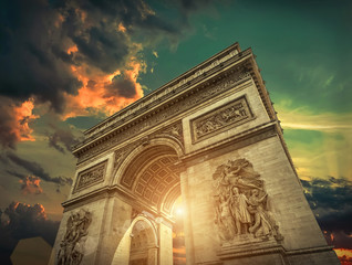 Arc de Triomphe in Paris under sky with clouds. One of symbols o