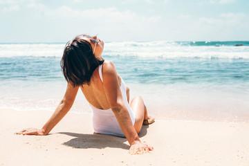 Woman enjoy with sun on beautiful sand ocean beach