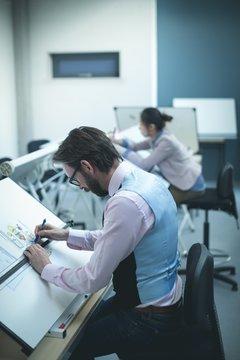 Executive working on blueprint