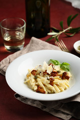 Creamy pasta  with chanterelles on plate