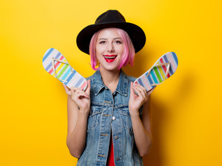 girl with pink hairstyle and flip flops shoes