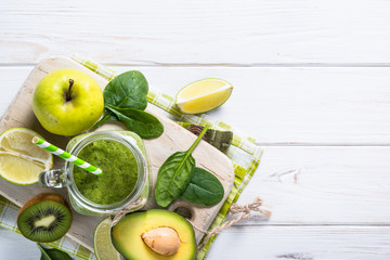 Green food background. Fresh fruit and smoothie on the table.