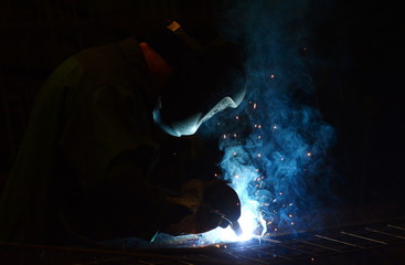 Working at the plant makes welding and cutting of metal