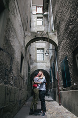 young couple in love kissing on cozy narrow street in Bern, Switzerland
