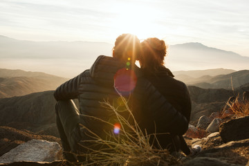 Couple overlooking palm springs from keys view in joshua tree national park