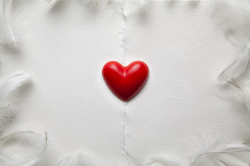 Valentines Day background - red heart and feathers