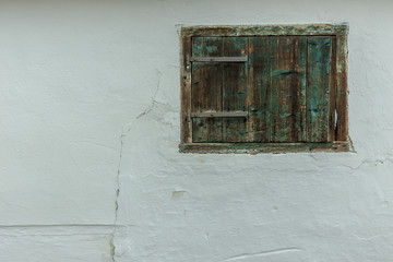 Chalked wall with old closed window