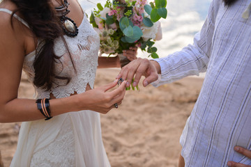 wedding in the style of Boho. wedding decoration and a ceremony near the sea