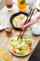 Gyoza Dumpling japan food with chopstick hand on