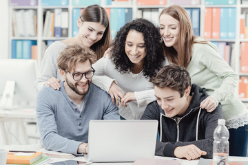 Group of students connecting with a laptop