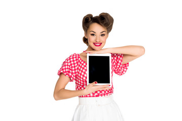portrait of smiling woman in pin up style clothing showing tablet isolated on white