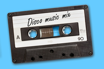Disco music mix written on vintage audio cassette tape, blue background