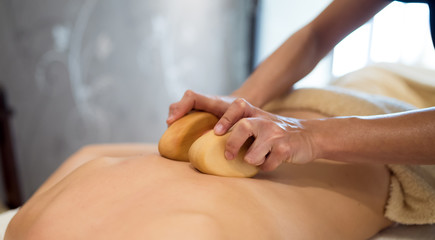 Masseur treating patient with therapeutic massage