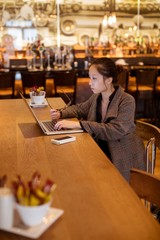 Female executive using laptop at table