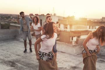 Summertime rooftop party sack race