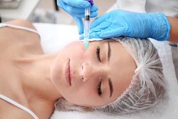 Beautician making injection in woman's face, closeup. Biorevitalization procedure