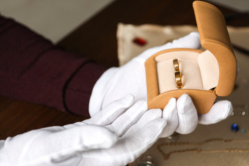 Jeweler holding box with rings, closeup