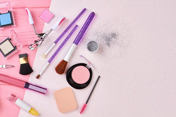 Blusher, brushes, lipstick and makeup equipment. Various cosmetics products, top view. Cosmetics items and copy space.
