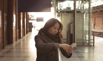 Beautiful woman using mobile phone