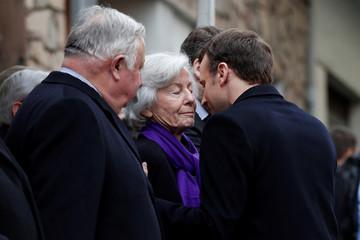 French President Emmanuel Macron greets Claude Erignac's widow Dominique Erignac during a ceremony in tribute to the slain French prefect Claude Erignac in Ajaccio