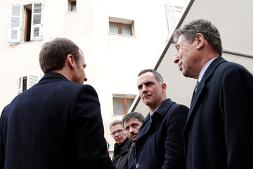 French President Emmanuel Macron speaks with the President of the Corsican Executive Council Gilles Simeoni and former minister and former Bastia mayor Emile Zuccarelli, during a ceremony in tribute to the slain French prefect Claude Erignac