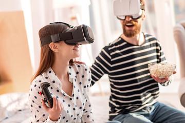 f5528e221cc Virtual game. Vigorous optimistic gorgeous woman shouting while ...