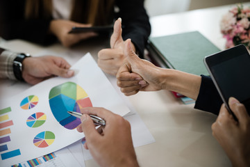 A group of business men and women are meeting together to see graphs about business marketing sales target. teamwork business meeting concept.