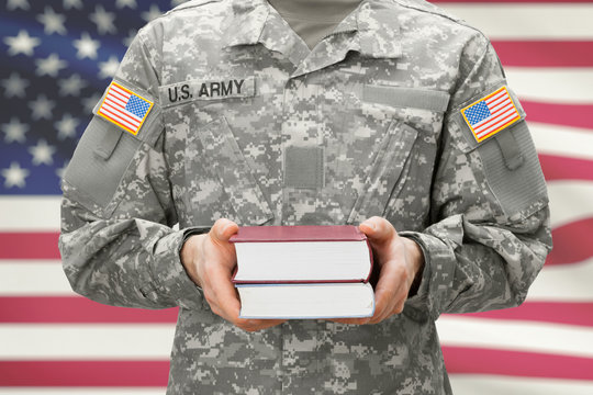 USA army collage recroit holding books in his hands