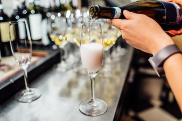 waiter brings glasses of champagne