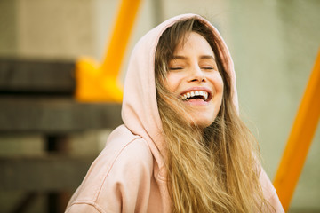 cool young woman in pink hoodie