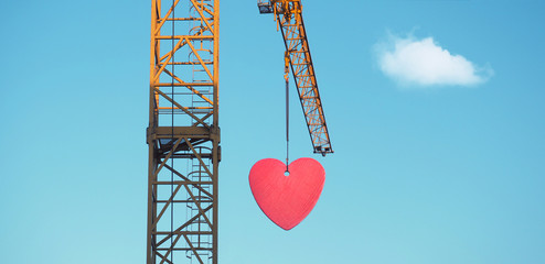 Love is in the air - crane with heart attached