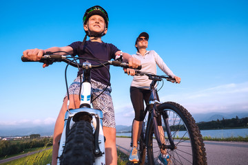 Mother and son starting ride a bicykle