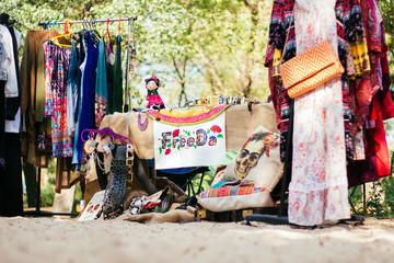 Flea market, shop on street clothes, bazaar festival
