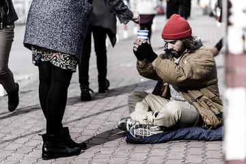 Woman giving money