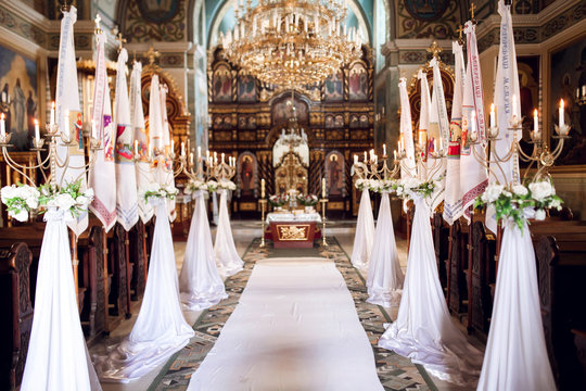 Interior of church with decoration for wedding with candels light