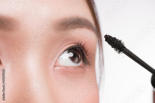 ba3de85fc Eye make up apply. Mascara brush. Portrait of beautiful asian woman with  perfect fresh face skin.