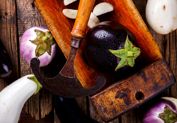 Eggplants are different. Vegetables. Variety of shapes and colors  on the wooden background Vintage Kitchen cooking utensils.Food or Healthy diet concept.Super Food.Vegetarian.selective focus.