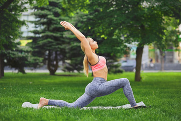Woman making asana exercises outdoors