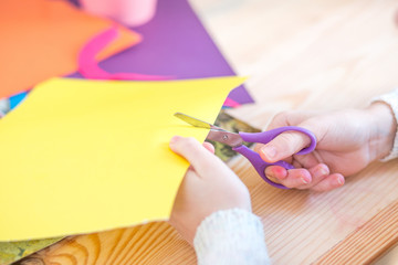 Child with scissors cut paper