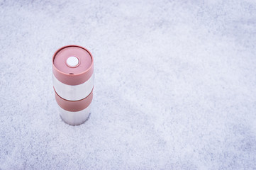 the thermos stands on the snow