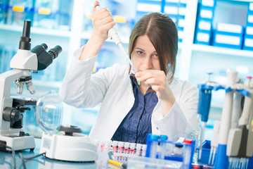 young woman lab assistant in a genetics lab