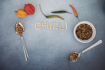 Chilli  food background with chilli flakes and whole chillies, taken with copy space