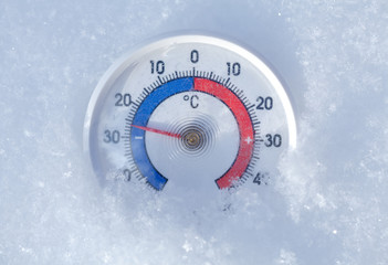 Outdoor thermometer in snow shows minus 26 Celsius degree frosty winter weather concept