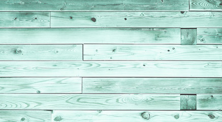 Colorful teal wood board panels background. Rough wood texture surface with blue and green tints.