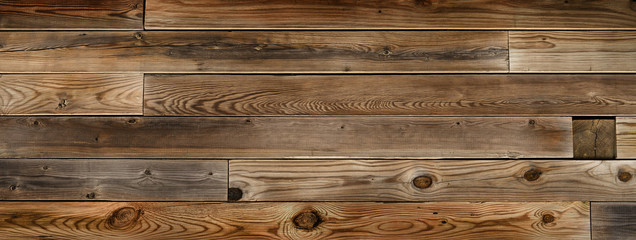 Dark neutral brown wood background with horizontal lines. Flat wooden panels with grain and knots.