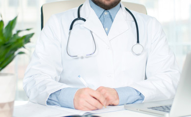 Healthcare and medical concept. Doctor writing prescription